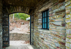 Arched door and stone wall stock images
