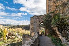 Arched door in the castle Stock Images