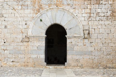 Arched door in the facade Stock Photo