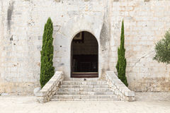 Arched door in the facade Stock Images