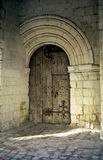 Arched door at Fontevraud church Stock Images