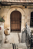 The arched door with metal lattice in Jerusalem, Israel Stock Photos