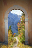 Arched door and mountainous autumn landscape Royalty Free Stock Image