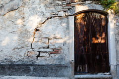 Arched Door in Old Weathered House in Pula Royalty Free Stock Photos