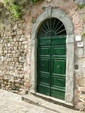 Arched door Tuscany stone royalty free stock photography