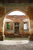 Arched doors in ancient building. View through the Arched doors in ancient building Stock Photo