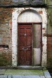 Arched doorway that looks shabby and in need of attention stock image