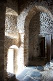 Arched Doorway in a Medieval Castle. An arched doorway in a medieval castle that has been altered to have a smaller opening. Vertical shot Royalty Free Stock Photography
