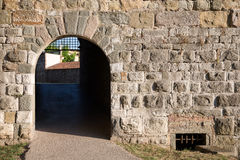 Arched Doorway in a Medieval Stone Wall Stock Photography