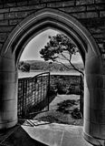 Arched doorway to lakeside patio Royalty Free Stock Photo