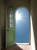 Arched Doorway to Starburst Sun Stock Photo