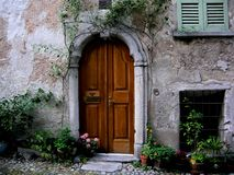 Arched entrance door Tuscany italy stock images