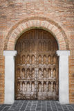 Arched entrance of a medieval palace. Stock Photos