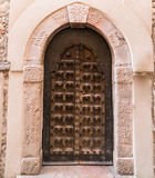 Arched entrance of a medieval palace. Stock Image