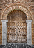 Arched entrance of a medieval palace. Royalty Free Stock Photography
