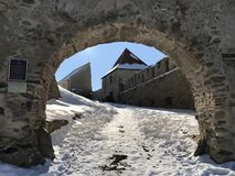 Old fortress Rupea in winter - Romania. Arched entrance in old, historical fortress of Rupea, German Reps; Hungarian: KÅ'halom, `mound of rocks`; Latin Ripa stock image