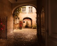Arched entrance to courtyard on old European building royalty free stock images