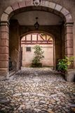 Arched entrance to courtyard on old European building royalty free stock photo
