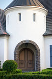 Arched Entryway to Upscale Home. An arched entry bordered with stone leads to the front doorway of an upscale home stock image