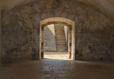 Fortress gate and staircases. Arched exit from an old fortress room, that frames a staircases Royalty Free Stock Images