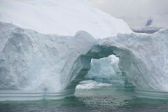 Arched formations in iceberg Stock Images