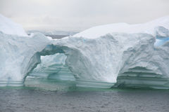 Arched formations in iceberg Royalty Free Stock Photos