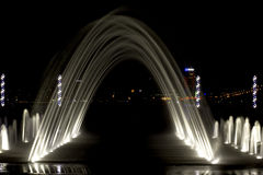 Arched fountain. In the background of  city at night, backlit closeup Stock Photography