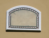 Arched Frame. Carved and painted, stone inside border royalty free stock photo