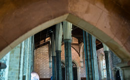 Arched frame over view of great hall Royalty Free Stock Image