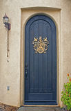 Arched front door on California home Royalty Free Stock Photos