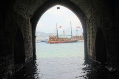 Arched galleries and rooms inside the ancient shipyard Alanya, Turkey Stock Photo