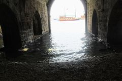 Arched galleries and rooms inside the ancient shipyard Alanya, Turkey Royalty Free Stock Images