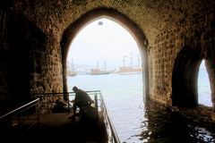 Arched galleries and rooms inside the ancient shipyard Alanya, Turkey.  Stock Photography
