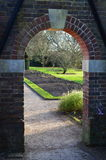 Arched garden entrance. Royalty Free Stock Photography