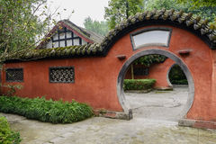 Arched gate of aged enclosure in Chinese traditional style Stock Photos