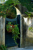 Arched Gate with Flower Basket Royalty Free Stock Photo