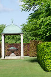 Arched Gazebo with Sculpture in English Garden Stock Image