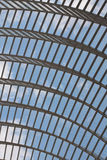 Arched glass roof with clouds Royalty Free Stock Photo