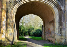 Arched Graffiti Walkway. Walkway under an arch with graffiti on walls Stock Photos