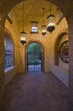 Arched Hallway With Lit Hanging Lights Stock Photography