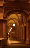 Arched historic passage in Vienna. Night view along old colonade of opera in Vienna, Austria Stock Image