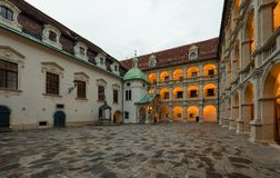 Arched inner courtyard of a Landhaus with a bronze fountain at sunset. Graz, Austria stock photo