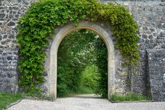 Arch in an old wall royalty free stock photo