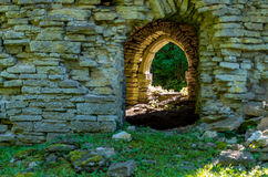 Arched limestone door Stock Images