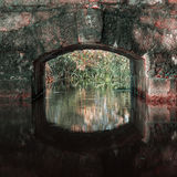 Arched masonry large granite boulders. The arch span of the bridge over the river with a strong old granite texture Royalty Free Stock Image