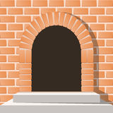 Arched medieval door in a brick wall with stairs Stock Photos