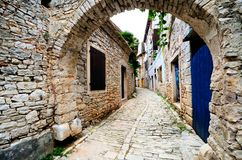 Arched medieval street in a European village Royalty Free Stock Images