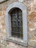 An arched medieval window with stone trim stock photo