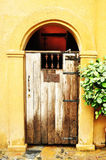 Arched medieval wooden door Royalty Free Stock Photography