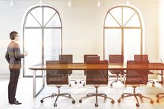 Arched meeting room interior, man stock image